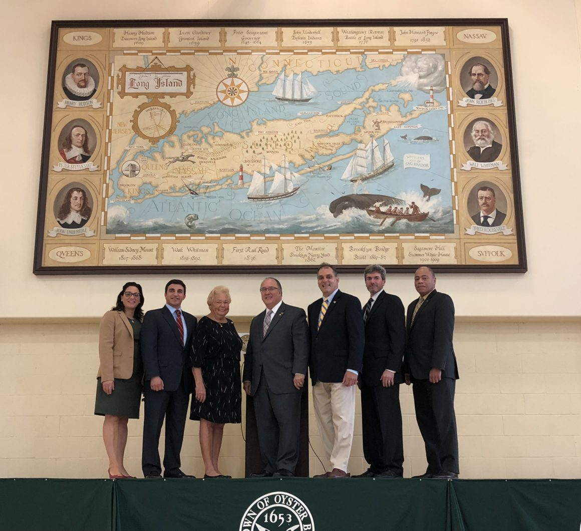 Town Returns Historic Mural Home to Hicksville